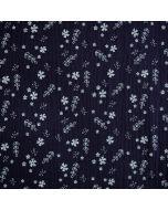 Weicher Musselin - Double Gauze Stoff in dunkelblau mit kleinen und feinen Pflanzen- und Blumenmotiven in weiss.