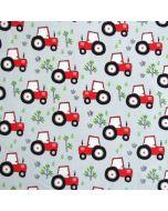 Bielastischer, weicher Jersey Stoff in hellblau mit roten Traktormuster - der Stoff ist perfekt für Kinderbekleidung und Unterwäsche.