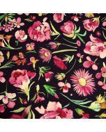 Canvas Stoff in schwarz mit bunten Blumenmuster in Aquarell-Stil in rosa-pink, grün und gelb-orange. Der Stoff ist aus 100% Baumwolle, mittelschwer für Taschen, Tageskissen oder andere Deko oder Bekleidung.
