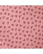 Weicher Musselin Stoff in altrosa, mit feinen, kleinen Herz-Motiven für Damen- und Kinderbekleidung. Nicht elastische Webware aus 100% Baumwolle.