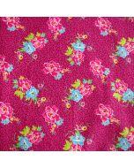 Popeline Stoff aus 100% Baumwolle in fuchsia-magenta mit Blumenmuster in pink-fuchsia und Hellblau.