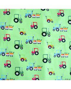Weicher, bielastischer Jersey Stoff in hellgrün mit Traktormuster - Stoffzusammensetzung: 95% Baumwolle, 5% Elastan