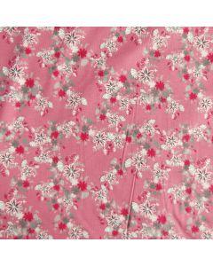 Bielastischer Jersey Stoff in blush mit buntem Blumenmuster - die Musterung ist klein und fein, der Stoff ist perfekt für Damenbekleidung.