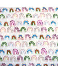 Musselin Stoff in offwhite mit bunten Regenbogen-Muster für Kinder- und Damenbekleidung.
