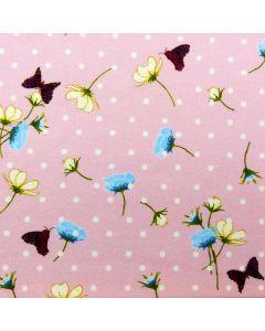 Jersey Stoff in rosa mit feinen, weissen Tupfen, Schmetterlingsmuster und Blumenmotiven.