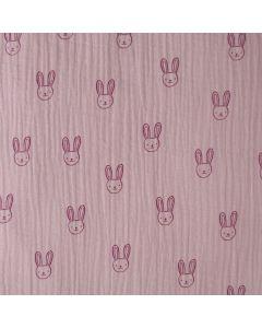 Musseline (Double Gauze) Stoff in rosa mit weissem Hasenmuster in weiss - der Stoff ist eine blickdichte Webware aus 100% Baumwolle für Kinderbekleidung.
